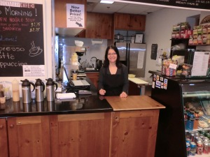 Stela serving smiles and coffee at The Bookmark Cafe.